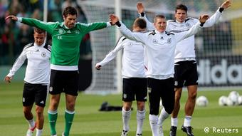 Source News Feed: EMEA Picture Service ,Germany Picture Service Germany's national soccer coach Joachim Loew gestures during an official training session ahead of the Euro 2012 in Gdansk, June 4, 2012. REUTERS/Thomas Bohlen (POLAND - Tags: SPORT SOCCER)