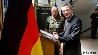 Source News Feed: EMEA Picture Service ,Germany Picture Service German Defence Minister Thomas de Maiziere signs a guest book at international peace keeping force (KFOR) headquarters as he stands next to Erhard Drews (L) German commander of KFOR in Pristina June 4, 2012. REUTERS/KFOR/Pool (KOSOVO - Tags: MILITARY POLITICS)