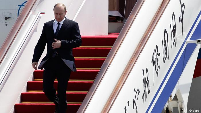 Russian President Vladimir Putin walks down from the airplane on his arrival at the Beijing Capital International Airport in Beijing, China Tuesday, June 5, 2012. Putin is in Beijing for a regional security summit and talks with Chinese leaders expected to focus on Syria, Iran, and energy cooperation. (AP Photo/Andy Wong)