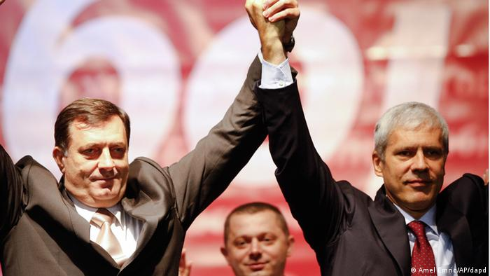Prime Minister of Republic of Srpska, Milorad Dodik, Prime Minister of Republic of Srpska, who is running on the Alliance of Independent Social-Democrats (SNSD) list for the post of the Republic of Srpska (RS) president, left, hold hands with Serbian President Boris Tadic, right, during a pre-election rally in the Bosnian town of Doboj, 100 km north of Sarajevo, on Wednesday, Sept. 29, 2010. National elections in Bosnia and Herzegovina are scheduled on Sunday Oct. 3, 2010, with a total of 39 parties and 11 coalitions registered to run for Bosnian tripartite Presidency and National Assembly this year. (ddp images/AP Photo/Amel Emric)