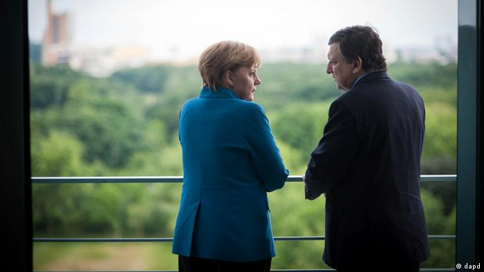 German Chancellor Angela Merkel (CDU) and EU Commission President Jose Manuel Barroso look out from a balcony at the chancellery in Berlin