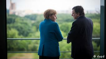 Merkel and Barroso talking in Berlin