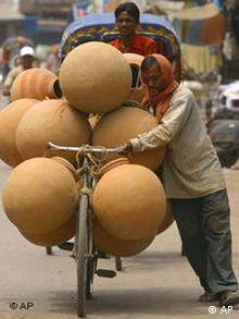 A man transports earthenware pots on his bicycle