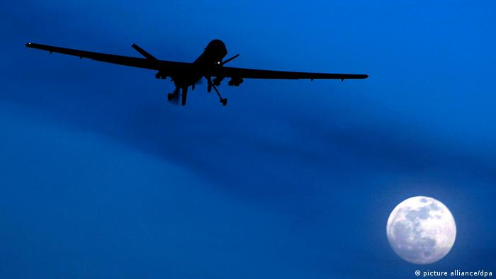 In this Jan. 31, 2010 file photo an unmanned U.S. Predator drone flies over Kandahar Air Field, southern Afghanistan, on a moon-lit night. Drones are often called the weapon of choice of the Obama administration, which quadrupled drone strikes against al-Qaida targets in Pakistan's lawless tribal areas, up from less than 50 under the Bush administration to more than 220 in the past three years. (AP Photo/Kirsty Wigglesworth, File)