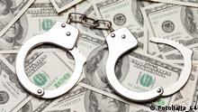 Crime law handcuffs arrests paper dollars currency Handcuffs on dollar currency © ia_64 #28990358