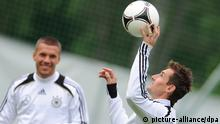 Germany's Lukas Podolski (L) and Miroslav Klose during a training session of the German national soccer team on the training pitch next to hotel Dwor Oliwski in Gdansk, Poland, 5 June 2012. The UEFA EURO 2012 will take place from 08 June to 01 July 2012 and is co-hosted by Poland and Ukraine. Photo: Andreas Gebert dpa