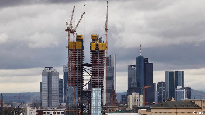 The new headquarters of the European Central Bank, center, rises in front of the skyline of Frankfurt, Germany, Thursday, April 26, 2012. The building is supposed to be finished in 2014. (AP Photo/Michael Probst)