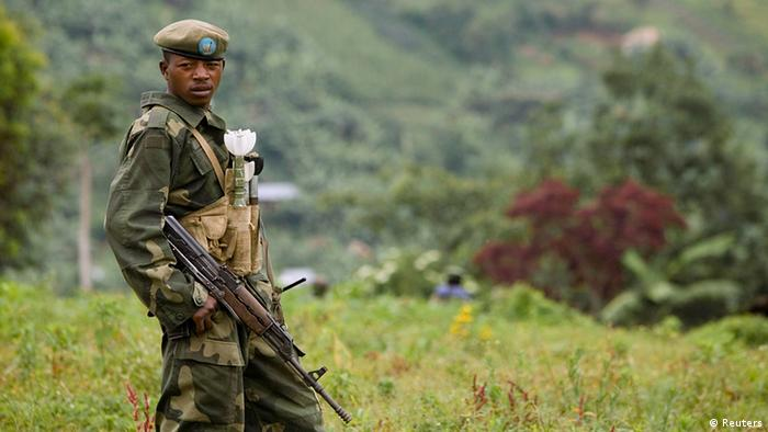 A Congolese government soldier stands guard at a military outpost between Kachiru village and Mbuzi hill, in eastern Democratic Republic of the Congo