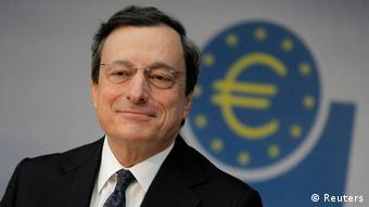 The Euro logo is reflected in the glasses of European Central Bank's (ECB) President Mario Draghi as he attends the monthly news conference in Frankfurt