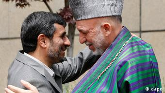 Iranian President Mahmoud Ahmadinejad, left, welcomes his Afghan counterpart Hamid Karzai,as he arrives to attend a summit meeting with Iran, Afghanistan and Pakistan officials, in Tehran, Iran, Sunday, May 24, 2009. (ddp images/AP Photo/Vahid Salemi)
