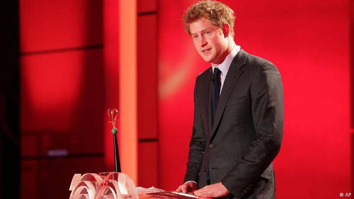 In this photo taken Saturday Dec. 18, 2010, Britain's Prince Harry delivers a speech after he was awarded at the charity gala 'Ein Herz fuer Kinder' (A Heart for Children) in Berlin. (ddp images/AP Photo/Peter Mueller, Pool)