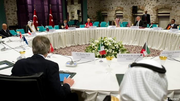 World diplomats attend a Friends of Syria meeting at the Dolmabahce Palace in Istanbul June 6, 2012. Seated at the table are (L-R): French Foreign Minister Laurent Fabius, Prime Minister and Foreign Affairs Minister Hamad Bin Jassim Bin Jabor Al-Thani of Qatar, Foreign Affairs Minister Ahmet Davutoglu of Turkey, U.S. Secretary of State Hillary Clinton, Foreign Affairs Minister Saud El-Faisal of Saudi Arabia, Britain's Foreign Secretary William Hague and Foreign Affairs Minister Abdullah Bin Zayed Al Nahyan of the United Arab Emirates. REUTERS/Saul Loeb/Pool (TURKEY - Tags: POLITICS)