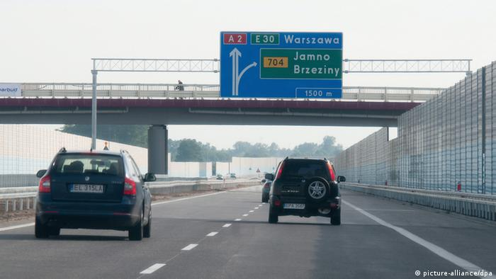 epa03252439 Cars ride on the new section C of A2 motorway between between Konotopa and Strykow, Poland 07 June 2012. The A2 motorway section was opened to traffic early 07 June. The motorway once completed will run from west to east through central Poland. EPA/Grzegorz MichaLowski POLAND OUT