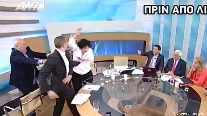 Screenshot of a scuffle on a Greek TV talk show