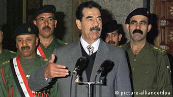 Iraqi President Saddam Hussein honours several Armed Forces officers with medals of bravery at a ceremony in Baghdad 04 January 2000. dpa pixel