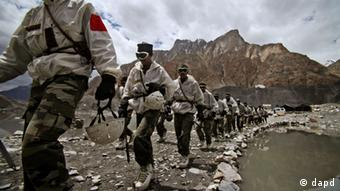In this July 19, 2011 photo, Indian army soldiers return after a training session at the Siachen base camp, in Indian Kashmir on the border with Pakistan. The nuclear-armed South Asian nations have competing territorial claims to Siachen, often dubbed the world's highest battlefield, and troops have been locked in a standoff there at an altitude of up to 20,000 feet (6,100-meter) since 1984, when Indian forces occupied the glacier. Indian and Pakistani foreign secretaries held talks Tuesday against the backdrop of a recent terror attack that killed 20 people in India's financial capital, ahead of the countries' foreign ministers meet Wednesday. (AP Photo/Channi Anand)