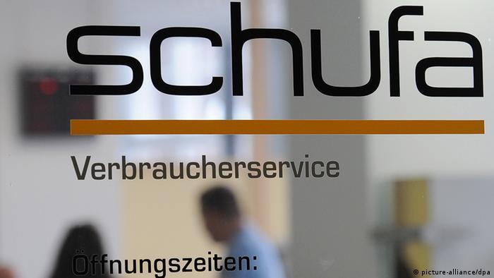 Schufa credit agency ogo on glass door