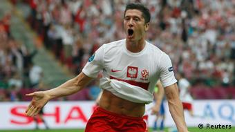 Source News Feed: EMEA Picture Service ,Germany Picture Service Poland's Maciej Rybus and Robert Lewandowski (C) celebrate as Greece's Kostas Chalkias lies on the ground, after scoring a goal during their Group A Euro 2012 soccer match at the National stadium in Warsaw June 8, 2012. REUTERS/Pascal Lauener (POLAND - Tags: SPORT SOCCER)