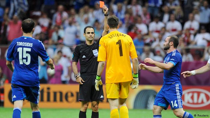 Source News Feed: EMEA Picture Service ,Germany Picture Service  Referee Carlos Velasco Carballo of Spain (2nd L) shows a red card to Poland's goalkeeper Wojciech Szczesny (2nd R) during their Group A Euro 2012 soccer match against Greece at the National stadium in Warsaw, June 8, 2012. REUTERS/Pawel Ulatowski (POLAND - Tags: SPORT SOCCER)
