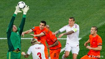 Denmark's Stephan Andersen (L) catches the ball during their Group B Euro 2012 soccer match