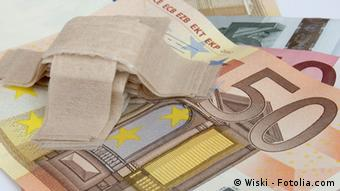 banknotes and sticking plaster