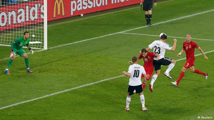 Germany's Mario Gomez (2R) scores a goal against Portugal's Rui Patricio during their Group B Euro 2012 soccer match at the new stadium in Lviv, June 9, 2012. REUTERS/Darren Staples (UKRAINE - Tags: SPORT SOCCER)
