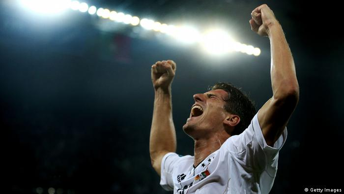 L'VIV, UKRAINE - JUNE 09: Mario Gomez of Germany celebrates scoring their first goal during the UEFA EURO 2012 group B match between Germany and Portugal at Arena Lviv on June 9, 2012 in L'viv, Ukraine. (Photo by Joern Pollex/Getty Images)