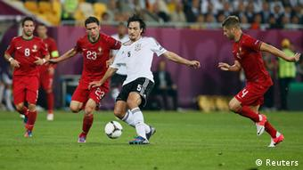 Germany's Mats Hummels (C) is challenged by Portugal's Helder Postiga (L) and Miguel Veloso during their Group B Euro 2012 soccer match at the New Lviv stadium in Lviv June 9, 2012. REUTERS/Michael Dalder (UKRAINE - Tags: SPORT SOCCER)