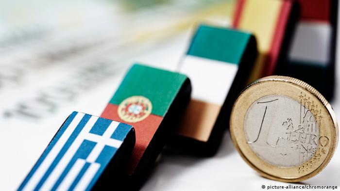 Symbol foto showing dominos painted like bailout countries' flags falling