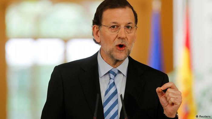 Spain's Prime Minister Mariano Rajoy gestures during a news conference