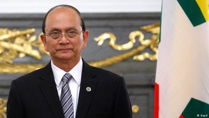 Myanmar's President Thein Sein stands near his nation's flag before speaking to the media after a meeting with Japanese Prime Minister Yoshihiko Noda, not pictured, held on the sidelines of the Mekong-Japan Summit at the State Guest House in Tokyo on Saturday, April 21, 2012. (AP Photo/Tomohiro Ohsumi, Pool)