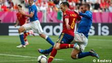 Spain's Andres Iniesta (L) tries to score against Italy's Daniele De Rossi during their Group C Euro 2012 soccer match at the PGE Arena in Gdansk, June 10, 2012. REUTERS/Juan Medina (POLAND - Tags: SPORT SOCCER)