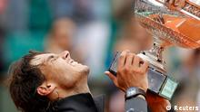 Rafael Nadal of Spain holds the trophy as he poses during the ceremony after defeating Novak Djokovic of Serbia during their men's singles final match at the French Open tennis tournament at the Roland Garros stadium in Paris June 11, 2012. REUTERS/Benoit Tessier (FRANCE - Tags: SPORT TENNIS)