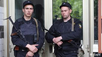 Russian police officers guard the entrance of the building where Russian opposition leader Alexei Navalny resides during a police search in Moscow, Russia, Monday, June 11, 2012. Investigators conducted a search of opposition leader and blogger Alexei Navalny's home in relation to a case of mass public disorder at Bolotnaya Square, lawyer Vadim Prokhorov told Itar-Tass on Monday. (AP Photo/Leonid Lebedev)