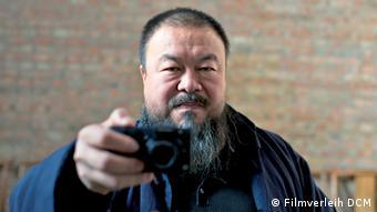 Chinese artist Ai Weiwei with photo camera
