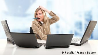 Stressed young woman using four laptops Stressing day at the office © Franck Boston #42132794