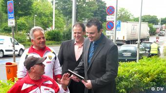 Mile and his team, along with representatives from the Macedonian consulate, at the IPC in Bonn