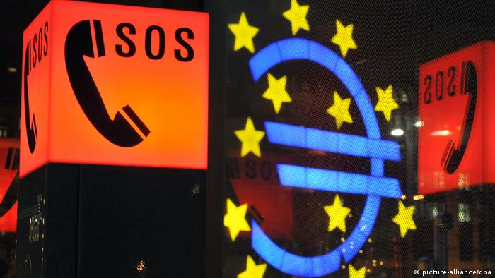 A euro symbol surrounded by SOS signs (Boris Roessler/dpa)