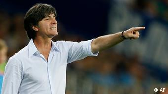 Germany head coach Joachim Loew gestures during the Euro 2012 soccer championship Group B match between the Netherlands and Germany in Kharkiv, Ukraine, Wednesday, June 13, 2012. (Foto:Frank Augstein/AP/dapd)