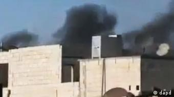Ugarit News agency footage purports to show black smoke rising from buildings in Homs