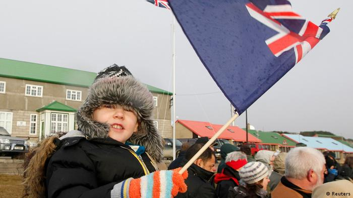 A child waves a Falklands flag in Stanley June 14, 2012, during commemorations for the 30th anniversary of the Falklands War. The tiny Falkland Islands will ask 3,000 inhabitants whether they want to stay part of Britain's self-governing overseas territories in a referendum designed to outflank Argentina's sovereignty claims to the South Atlantic archipelago.