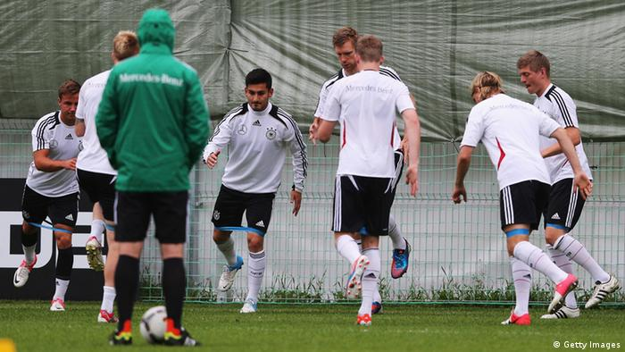 GDANSK, POLAND - JUNE 14: Player exercise during a Germany training session at their UEFA EURO 2012 training ground ahead of their UEFA EURO 2012 Group B match against Poland, at the Germany press centre on June 14, 2012 in Gdansk, Poland. (Photo by Joern Pollex/Getty Images)