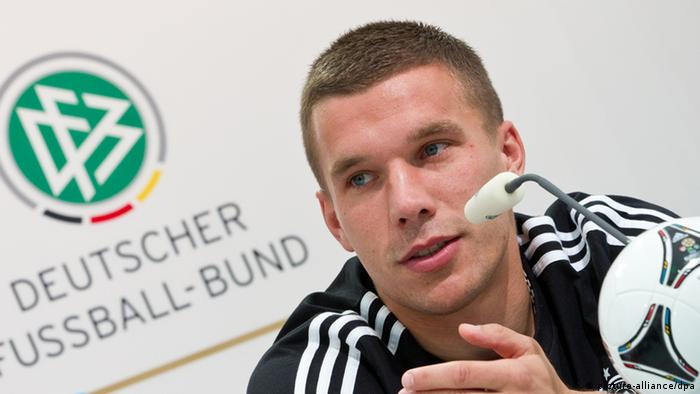 Germany's Lukas Podolski attends a press conference of the German national soccer team in Gdansk, Poland, 15 June 2012. The UEFA EURO 2012 takes place from 08 June to 01 July 2012 and is co hosted by Poland and Ukraine. Photo: Jens Wolf dpa +++(c) dpa - Bildfunk+++