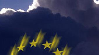 Stars of the EU flag superimposed on dark clouds
