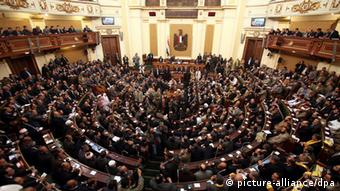 epa03264475 (FILE) A file photo dated 23 January 2012, shows the first Egyptian parliament session after the revolution that ousted former President Hosni Mubarak, in Cairo, Egypt. Media reports on 14 June 2012 state that the Supreme Constitutional Court ruled that one third of seats in parliament, allocated for independents, were void. The court described as unconstitutional an election law that allowed candidates from political parties to stand for independents' seats in the polls held late last year. It was not clear if the ruling means parliament would be dissolved. EPA/KHALED ELFIQI +++(c) dpa - Bildfunk+++