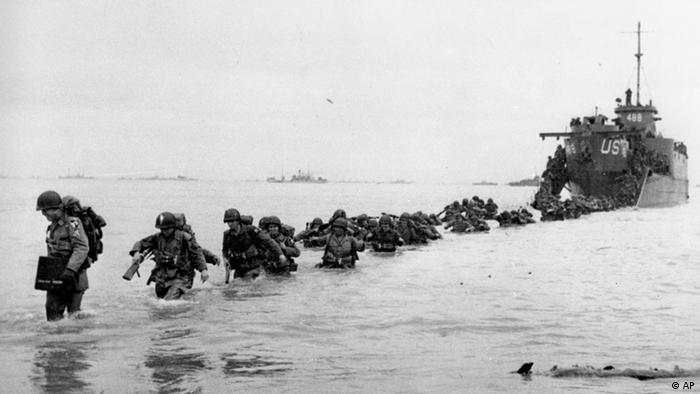 U.S. reinforcements wade through the surf from a landing craft in the days following D-Day and the Allied invasion of Nazi-occupied France at Normandy in June 1944 during World War II. In Normandy there will be a international ceremony celebrating the 60th anniversary of D-Day on June 6, 2004. (AP Photo/Bert Brandt)