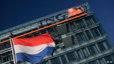 A Dutch flag flies outside ING head office in Amsterdam, Netherlands