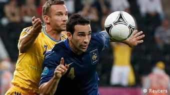 Ukraine's Andriy Shevchenko (L) challenges France's Adil Rami during their Group D Euro 2012 soccer match at Donbass Arena in Donetsk June 15, 2012. REUTERS/Michael Buholzer (UKRAINE - Tags: SPORT SOCCER)