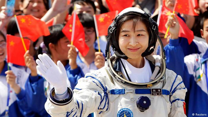 Liu Yang, China's first female astronaut, waves during a departure ceremony at Jiuquan Satellite Launch Center, Gansu province, June 16, 2012. China will send its first woman into outer space this week, prompting a surge of national pride as the rising power takes its latest step towards putting a space station in orbit within the decade. Liu, a 33-year-old fighter pilot, will join two other astronauts aboard the Shenzhou 9 spacecraft when it lifts off from a remote Gobi Desert launch site on Saturday evening. REUTERS/Jason Lee (CHINA - Tags: SCIENCE TECHNOLOGY TPX IMAGES OF THE DAY)