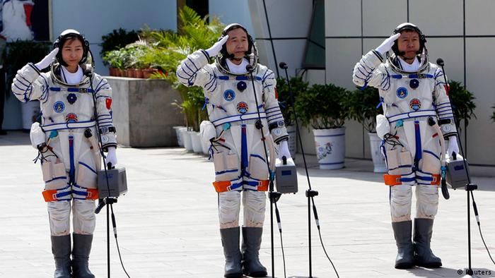 Chinese astronauts Jing Haipeng (C), Liu Wang ( R) and Liu Yang, China's first female astronaut